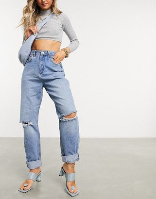 ASOS DESIGN high rise 'slouchy' mom jeans in midwash with rips