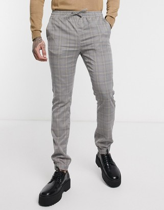 Asos DESIGN two-piece skinny pants with elastic waist in check