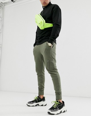 ASOS DESIGN skinny joggers with MA1 pocket in khaki