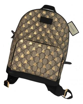 Gucci Gold Cloth Backpacks