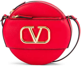 Valentino VLogo Circle Crossbody Bag in Red | FWRD