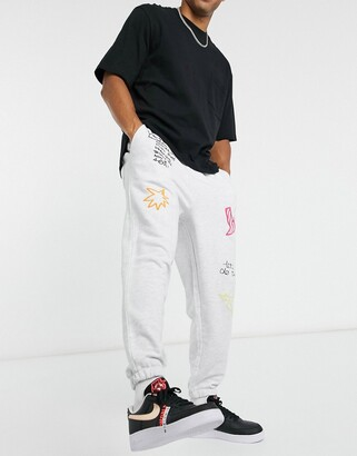 ASOS DESIGN co-ord oversized joggers with multi placement scribble print