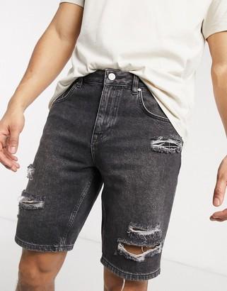 ASOS DESIGN rigid slim denim shorts in washed black with rips