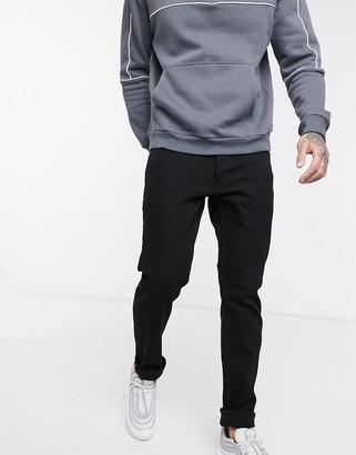Solid slim fit jean in dark black wash