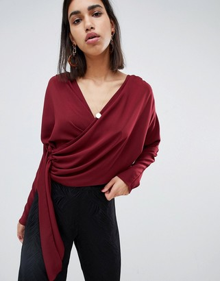 Asos Design DESIGN drape wrap long sleeve top with side button detail-Red