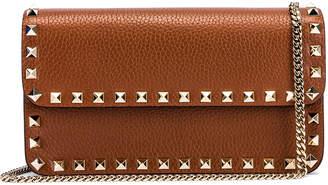 Valentino Rockstud Flap Crossbody Bag in Bright Cognac | FWRD