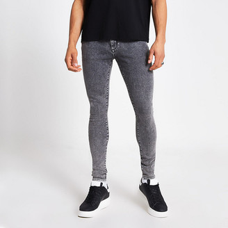 River Island Black acid wash Ollie spray on skinny jeans