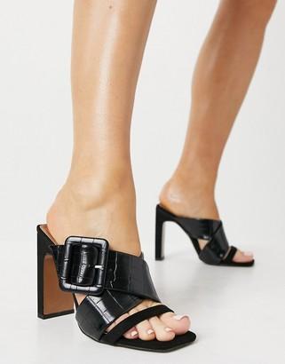 ASOS DESIGN Nanda buckle feature high heeled mules in black