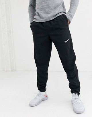 Nike Running woven sweatpants in black
