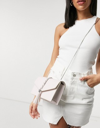 Truffle Collection across body envelope bag with chain detail in light pink