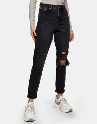 Topshop mom jeans with rips in washed black