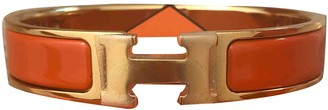 Hermã ̈S HermAs Clic H Orange gold and steel Bracelets