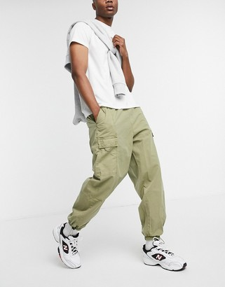 ASOS DESIGN oversized tapered cargo pants with wash in beige