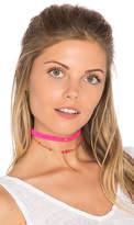 Ettika Star Charm Choker in Pink.