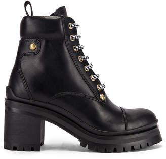 Miu Miu Lace Up Leather Ankle Boots in Black | FWRD