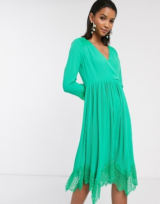 Liquorish wrap dress with pleated skirt and lace hem in green
