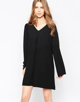 Minimum Moves V Neck Long Sleeve Swing Dress