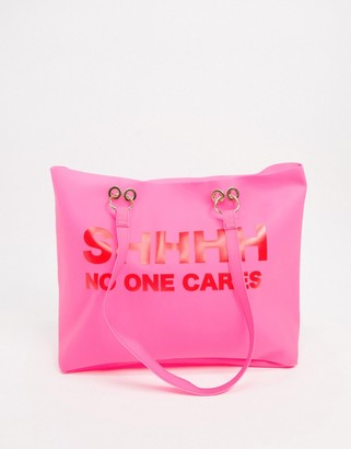 Skinnydip transparent tote bag with slogan in pink