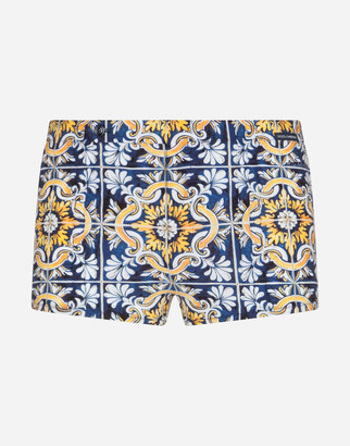 Dolce & Gabbana Swimming Trunks With Maiolica Print On A Blue Background