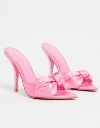 ASOS DESIGN Nester bow mules sandals on pointed insole in pink