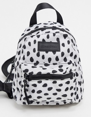 Consigned backpack with zip pocket in spot