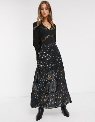 Religion party ruffle hem maxi skirt