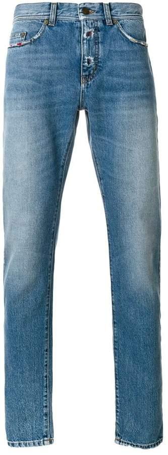 Saint Laurent low rise distressed trim jeans