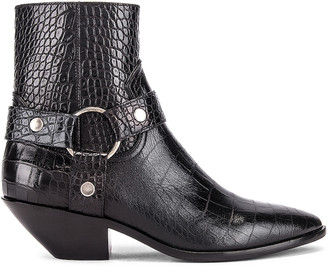Saint Laurent West Strap Zip Ankle Boots in Black | FWRD