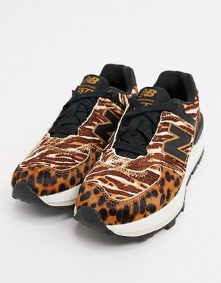 New Balance 574 platform sneakers in animal print