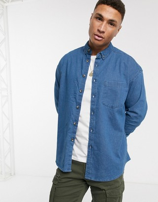 Asos DESIGN regular fit denim shirt in mid wash with mock horn buttons