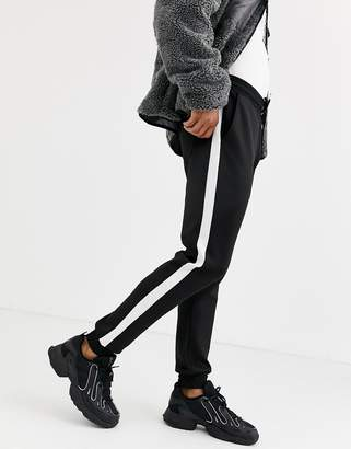 Asos Design DESIGN super skinny joggers in poly tricot with side stripe in black
