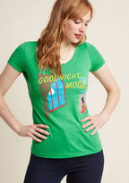 L-1068 Bring your love of literature to your wardrobe with this green T-shirt by Out of Print! Crafted with a flexible cotton blend for a comfy fit, this scoop-neck tee depicts the cover of the children's book classic, Goodnight Moon by Margaret Wise Brown. With