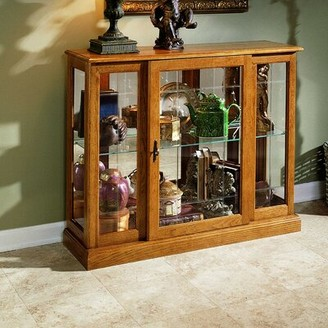 Purvoche Lighted Curio Cabinet Darby Home Co Color: Golden Oak