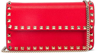 Valentino Rockstud Flap Crossbody Bag in Red | FWRD