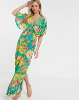 Design Slinky Jersey Beach Maxi Dress With Ring Detail In Oversized Tropical Fl Print Multi