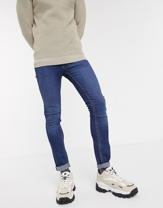 Jack and Jones Intelligence skinny fit super stretch jeans in mid blue
