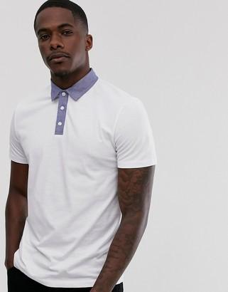 Asos Design DESIGN polo shirt with chambray collar in white