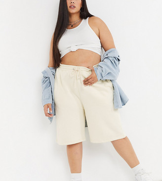 Collusion Plus exclusive shorts in pale yellow