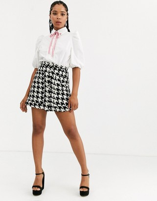Sister Jane mini skirt with faux pearl buttons in houndstooth