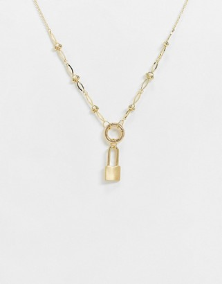NY:LON lock pendant necklace in gold