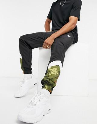 Puma Classics MCS logo sweatpants in black with camo detail