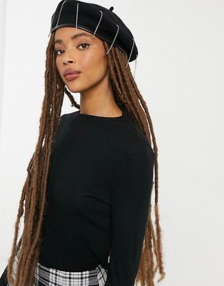 SVNX beret with rhinestone embellishment in black