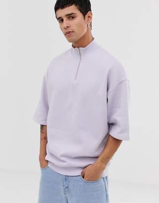 Asos Design DESIGN oversized short sleeve sweatshirt with zip neck in purple