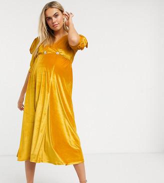 ASOS DESIGN Maternity velvet midi dress with puff sleeve and rhinestone button in ochre