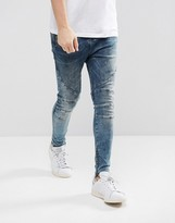 Religion Drop Crotch Skinny Jeans With Biker Knee Detail And Zip Ankle In Opium Wash Blue