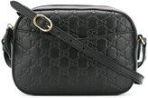 Gucci logo embossed shoulder bag - women - Leather - One Size