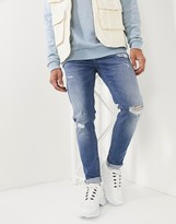 Asos Design DESIGN skinny jeans in mid wash blue with rips and destroy