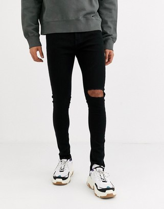 Criminal Damage essential skinny jeans in black with knee rips