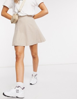 Monki Ulla check print mini skirt in beige