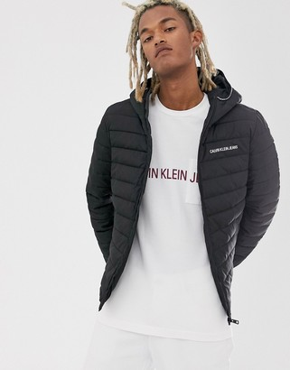 Calvin Klein Jeans padded hooded jacket in black with small logo